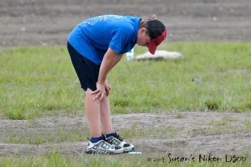 #2 is bummed after a poor disc golf shot.