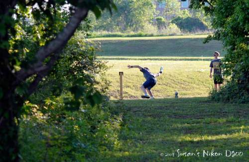 framing the #1 son as he tees off