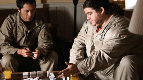 Miles (left) and Hurley debate time travel as they play dominos.
