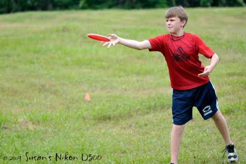 The #2 son lets the disc fly.