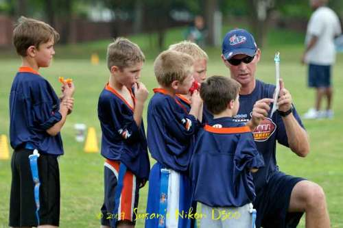 Coach Mike and his mighty mite players