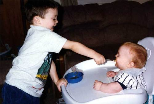#2 laughs as Big Brother feeds him.