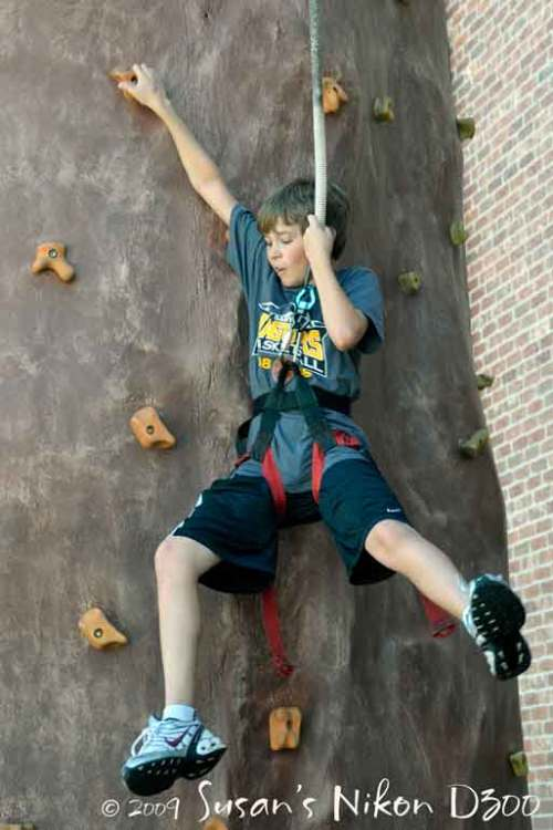 Chris is just hanging around . . . the rock wall.