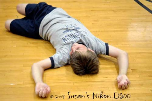#2 collapses on the floor after completing the obstacle course.