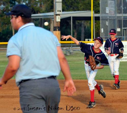 Cole throws towards first base in time to get the runner. (ISO 400)