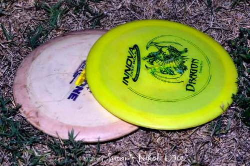 Discs with glow sticks taped on