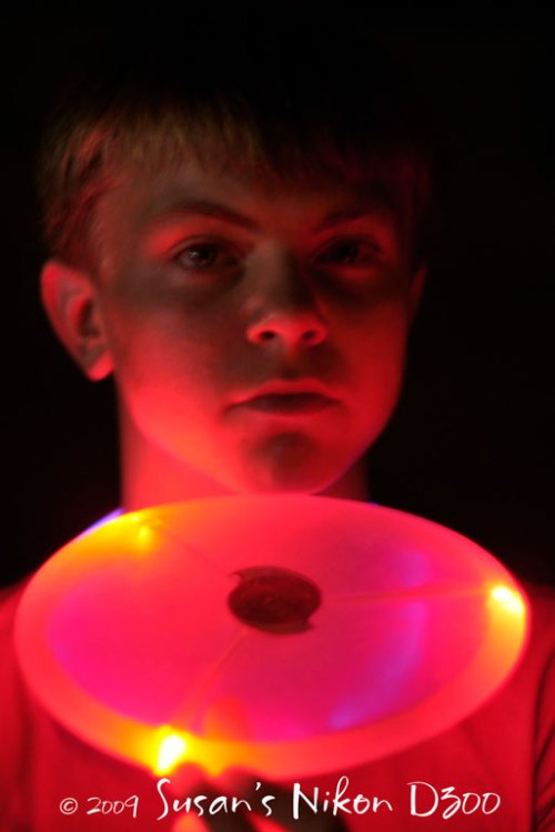 #2 son with his red glow disc