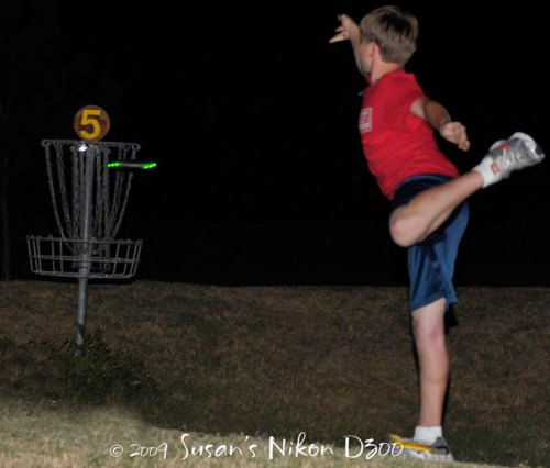 The #2 son's glowing putt approaches the basket. f/3.5, 1/60th of a second, ISO 250