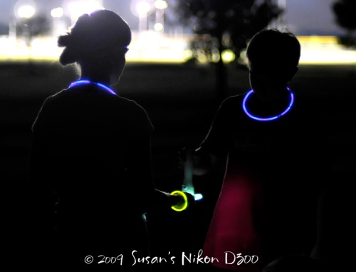 #2 glows Kelly's disc. f/1.4, 1/50th, ISO 800 (The light in the background is from a softball field.)