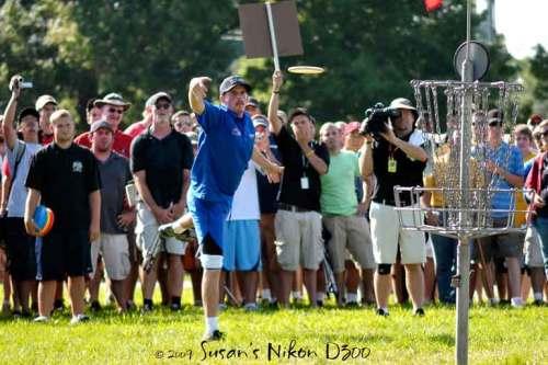 Josh Anthon watches his clutch par putt soar towards the basket on hole nine.