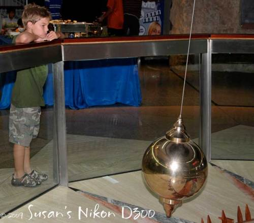 Eli ponders the pendulum.