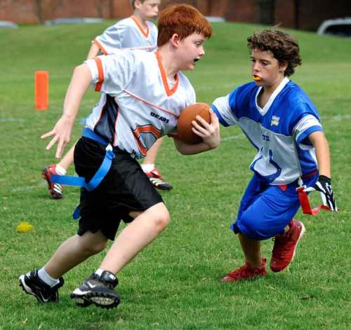 Caleb runs for yardage.