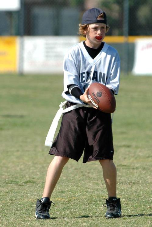 Longer-haired Kellen takes a turn at quarterback.