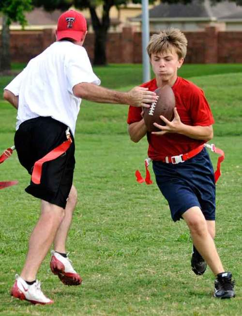 The #2 son takes the handoff from coach/quarterback Matt.