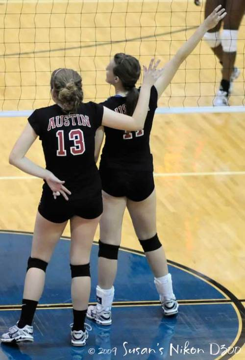 Kaitlyn M. and Mary Ellen signal their teammates.