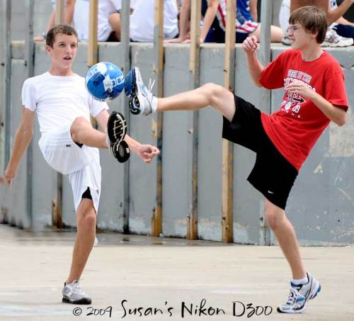Casey and Greg battle for the soccer ball.