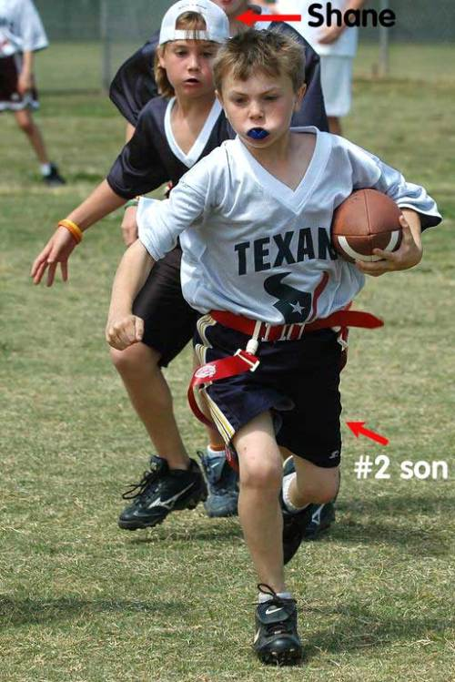 The #2 son scoots away from the pursuing Shane.
