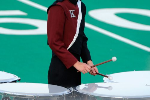 The percussionist is reflected in his drum.