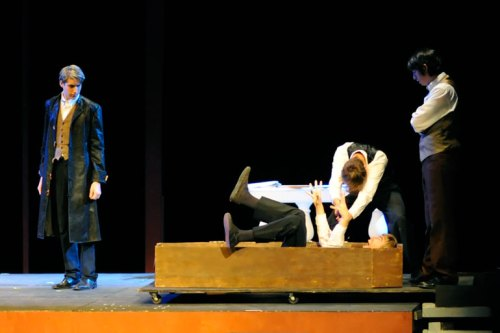 "Trey ""kills"" Dracul (Cameron) in a coffin as Jonathan (left) and Alec watch."