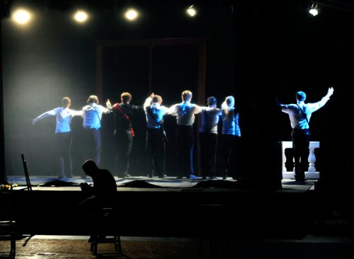 "Brian is silhouetted by the actors taking their ""Hamlet"" bows behind him."