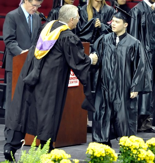 My #1 son is congratulated by our principal.