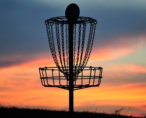 There's a beautiful background for this disc golf basket.