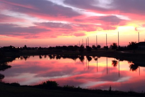 An amazing pink sunrise as captured by my iPhone 5.