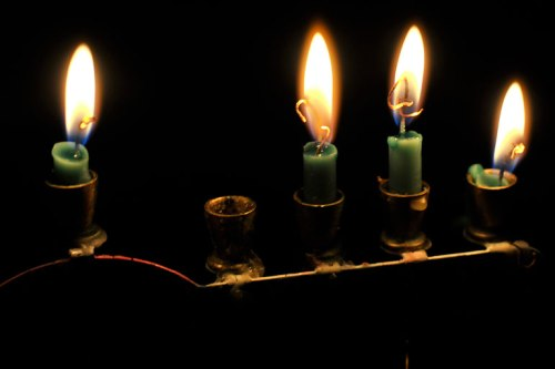 The third-night candles are burning low.