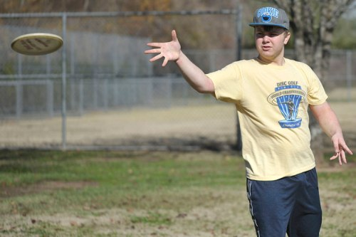 My younger son sends the disc flying towards Eric.