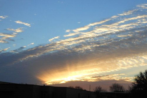 The sun's rays emerge.