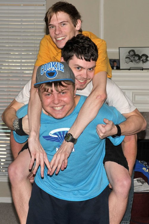 "Making an indoor totem pole are my two sons and my ""third son,"" Chase."