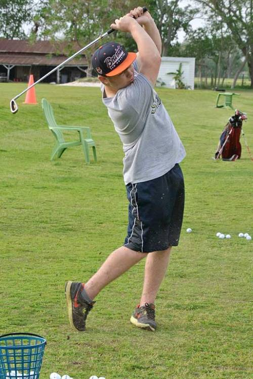My younger son, the Mister, and I went to a driving range last Monday.