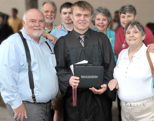 The motley crew: The Mister, Uncle Mike, #1 son, Aunt Carol, me, and Grandma surround the kid after his graduation last Saturday.