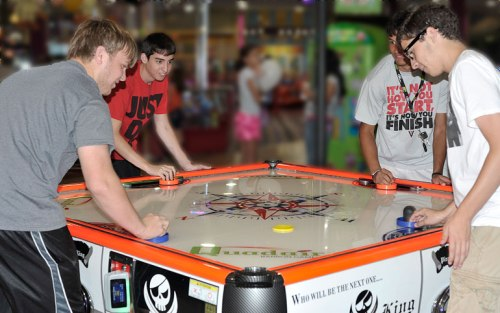 The Core 4 plays quad air hockey.