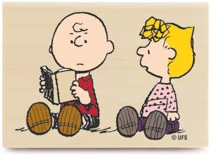 Good, old Charlie Brown reads to Sally
