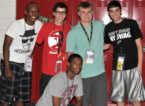 The kid surrounded by his besties: Michael, Ricky, and Jared, with Marcus kneeling.