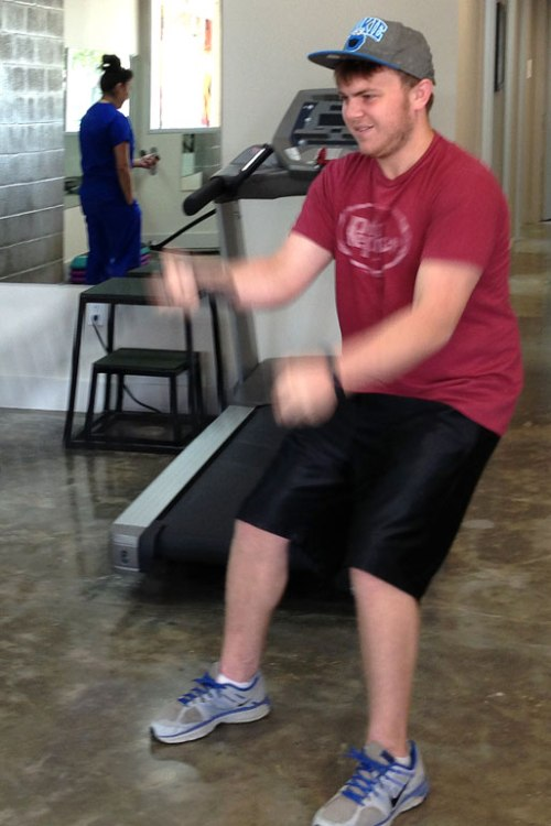 My younger son works the ropes while rehabbing his throwing shoulder.