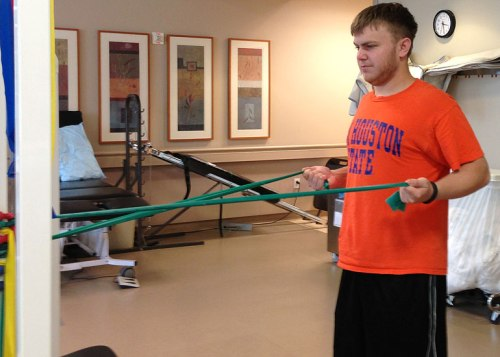 The kid works the bands during his first physical therapy session yesterday.