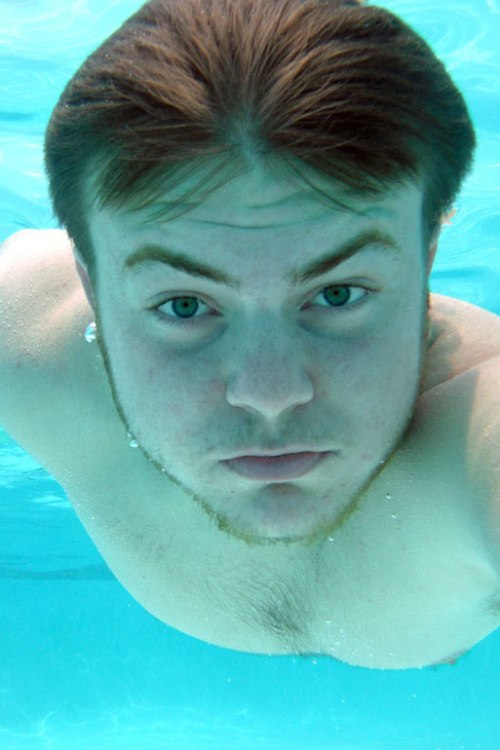 My younger son snaps his photo underwater in our pool using our new Fuji FinePix XP60.
