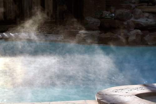 Steam rises in the cold air from our swimming pool.