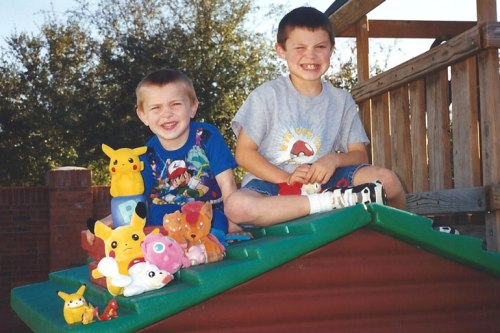 The boys on their play cottage in 1999 with their  Pokémon collection
