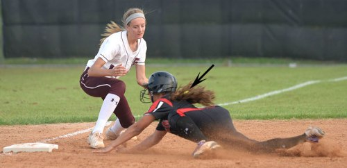 Alyssia slides into third base. Note that the ball is in the fielder's glove.