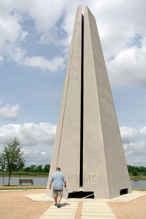 The Mister is dwarfed by the Remembrance Tower.