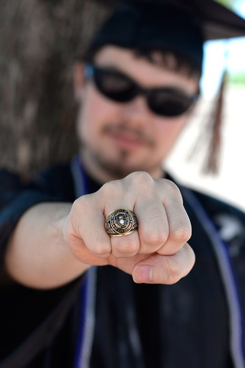 Jake shows off his class ring Green Lantern style.