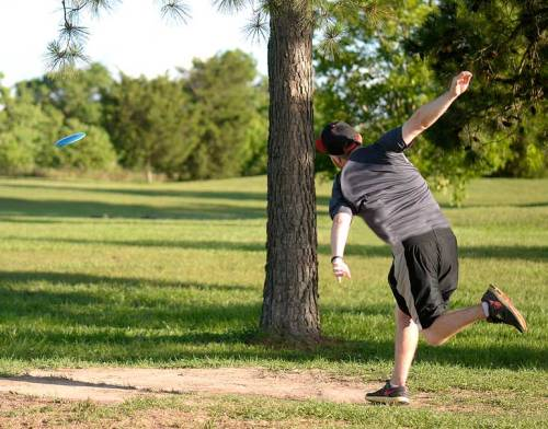 I'm back shooting disc golf now that my thumb joint feels better. Here C.J. tees off.