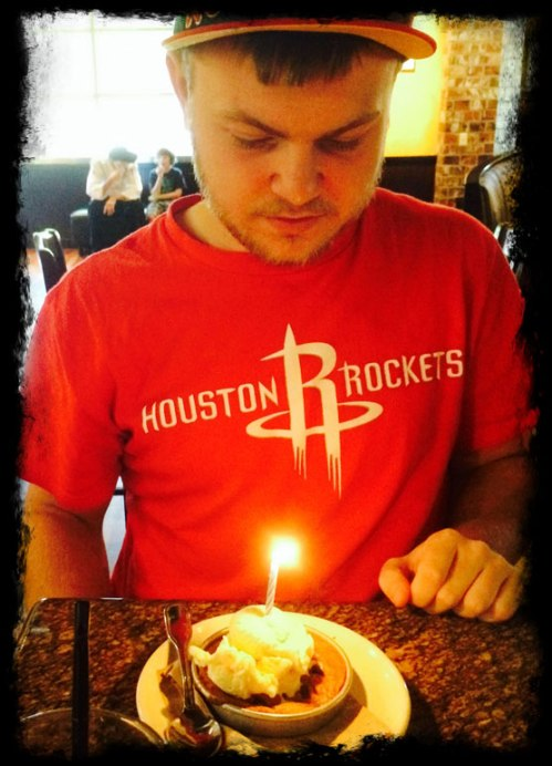 C.J. is ready to blow out the candle on his mini pizookie at BJ's.